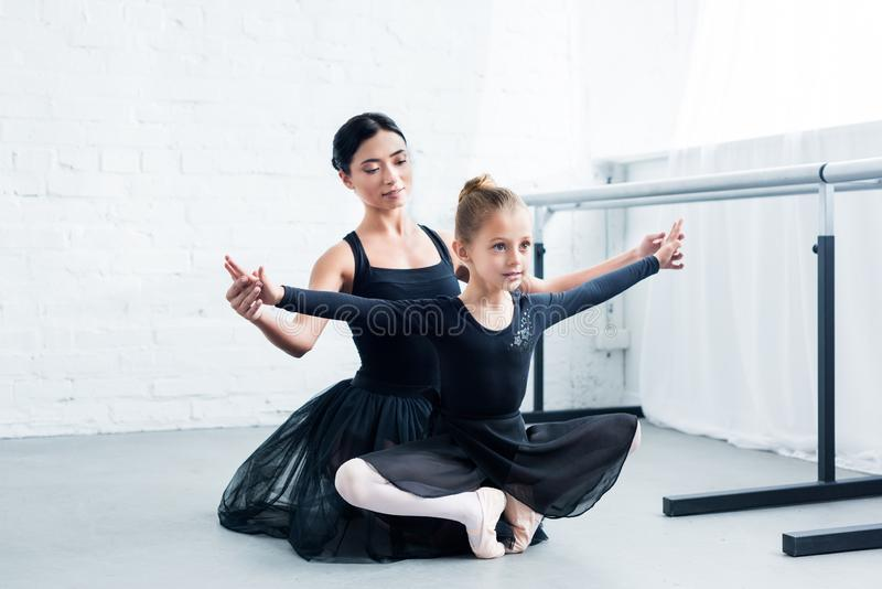 young ballet teacher training cute flexible child royalty free stock photography