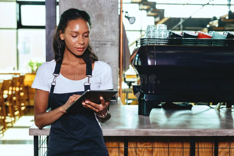 Young barista using digital tablet stock images