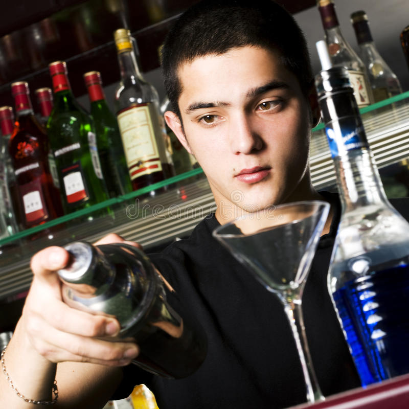 Young barman royalty free stock photography