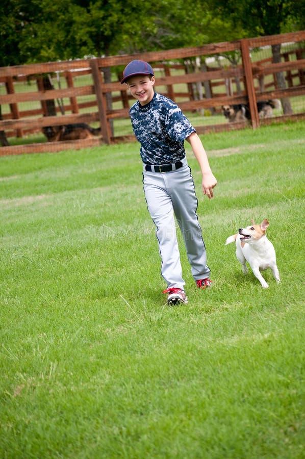 Young baseball boy and his dog stock image