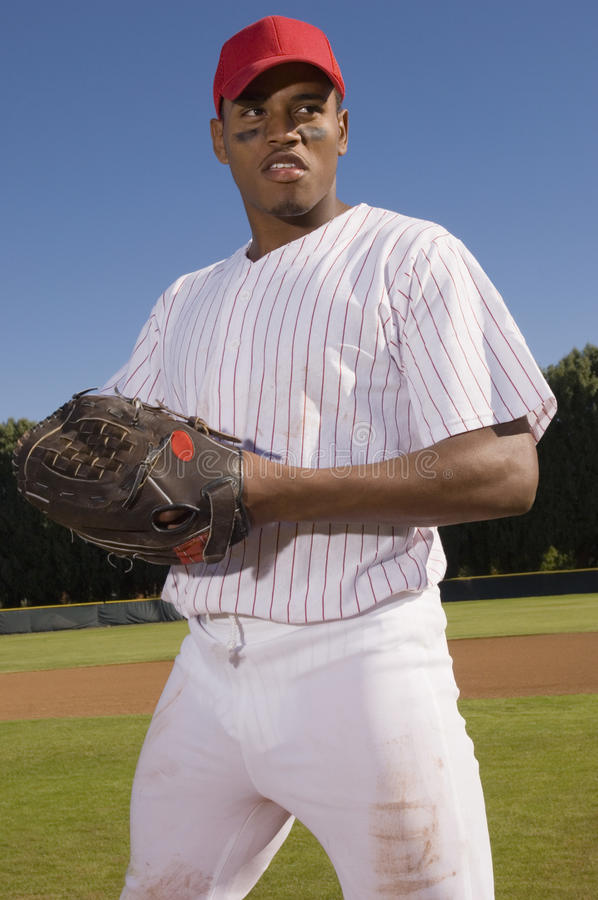 Young Baseball Pitcher Standing On Field royalty free stock photo