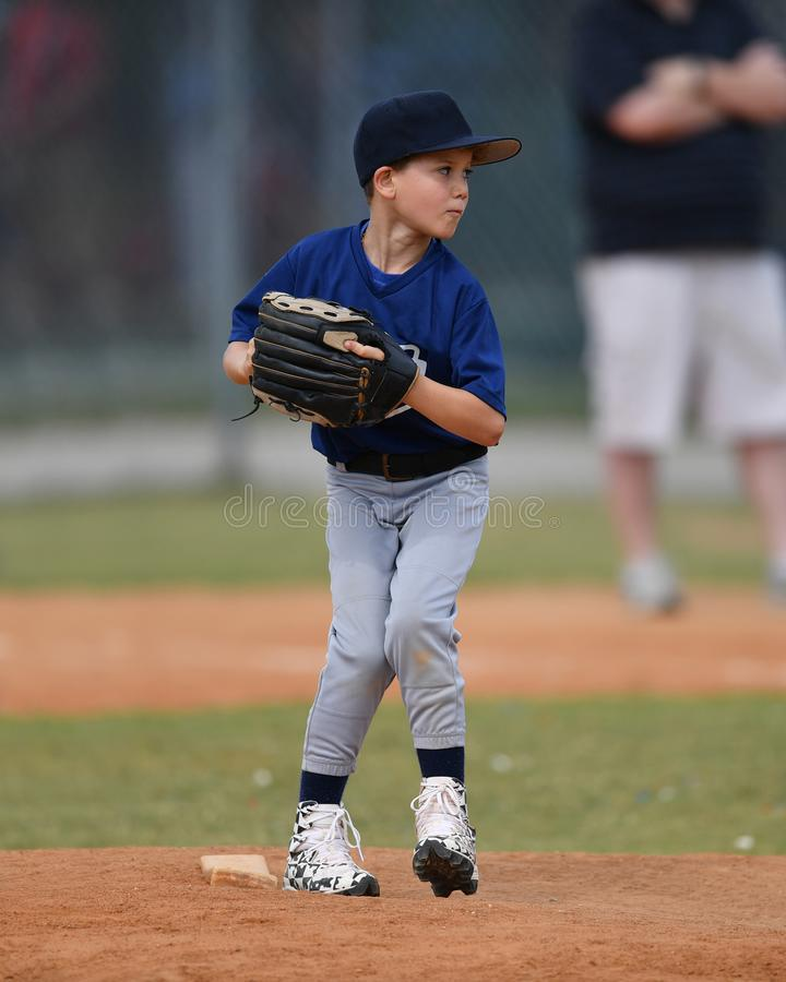 Young boy pitching the ball during a Baseball game royalty free stock photography
