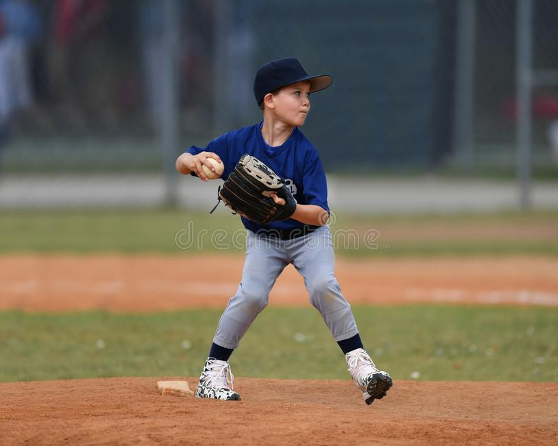 Young boy pitching the ball during a Baseball game stock photos
