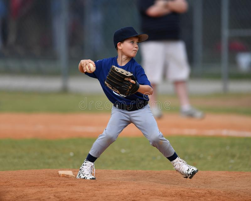 Young boy pitching the ball during a Baseball game royalty free stock photo