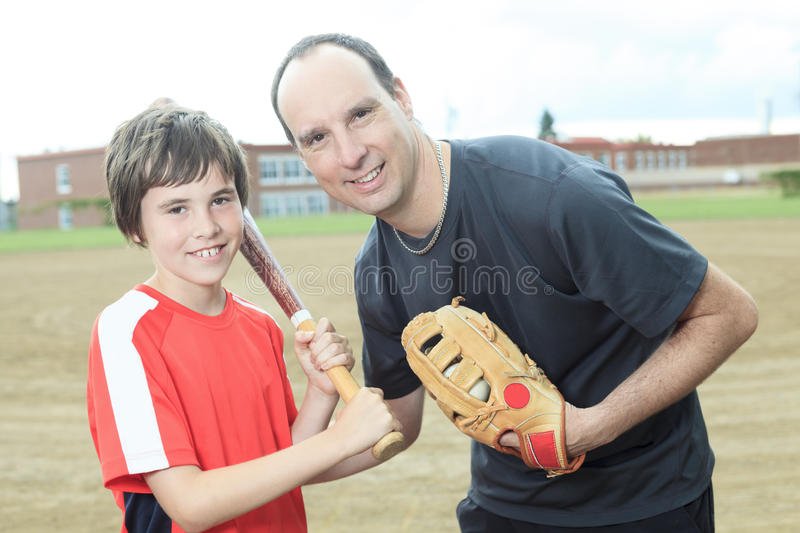 Young baseball player in a field royalty free stock photos