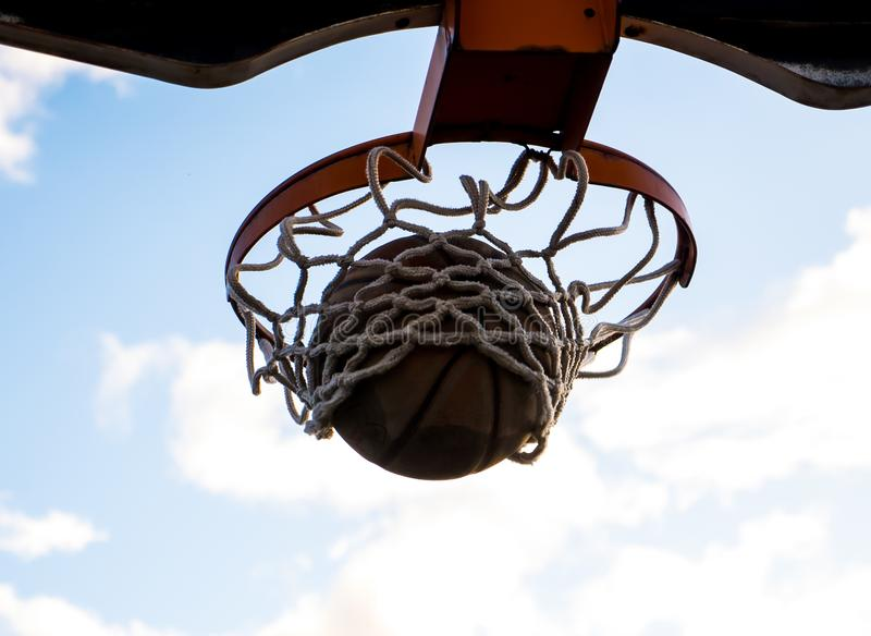 A Young Basketball Player Dreams of March Madness stock image