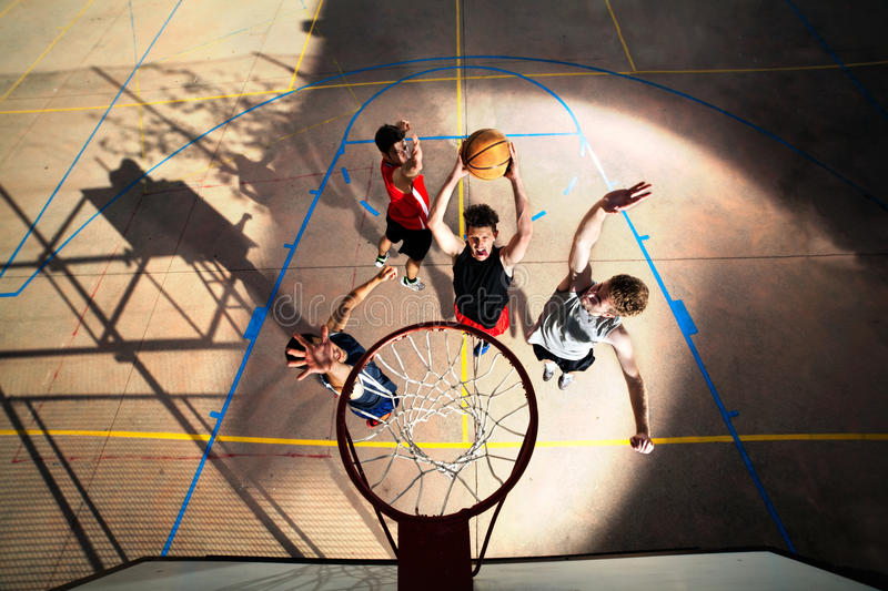Young basketball players playing with energy stock images
