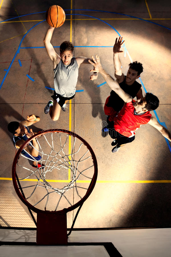 Free Young Basketball Players Playing With Energy And Power Stock Images - 63106774