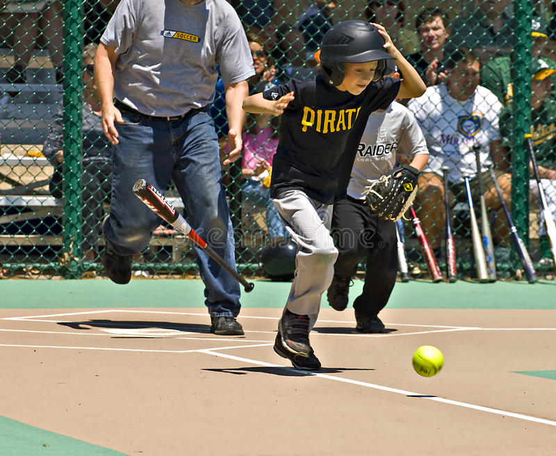 Young Batter Running to First Base royalty free stock photo