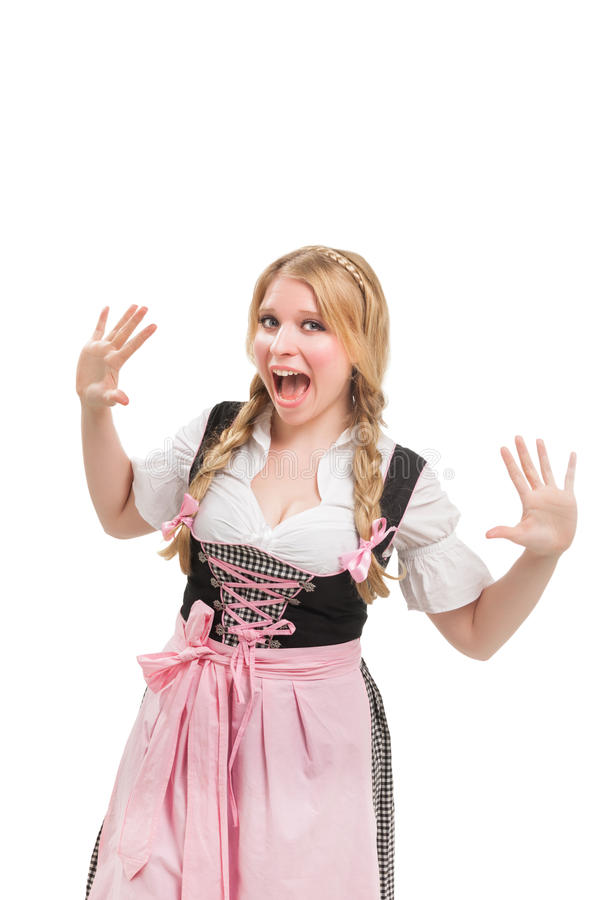 Young Bavarian woman in dirndl. Isolated on white background royalty free stock images