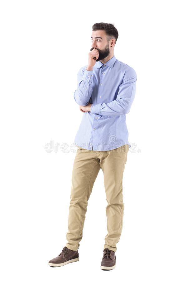 Young bearded adult business man in formalwear thinking and looking up with hand on chin stock photos