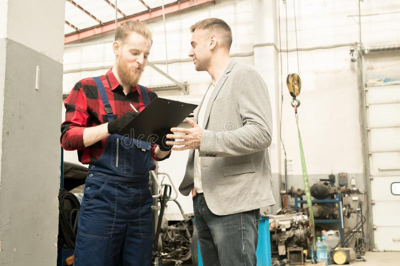 Car Technician Talking To Client royalty free stock photos