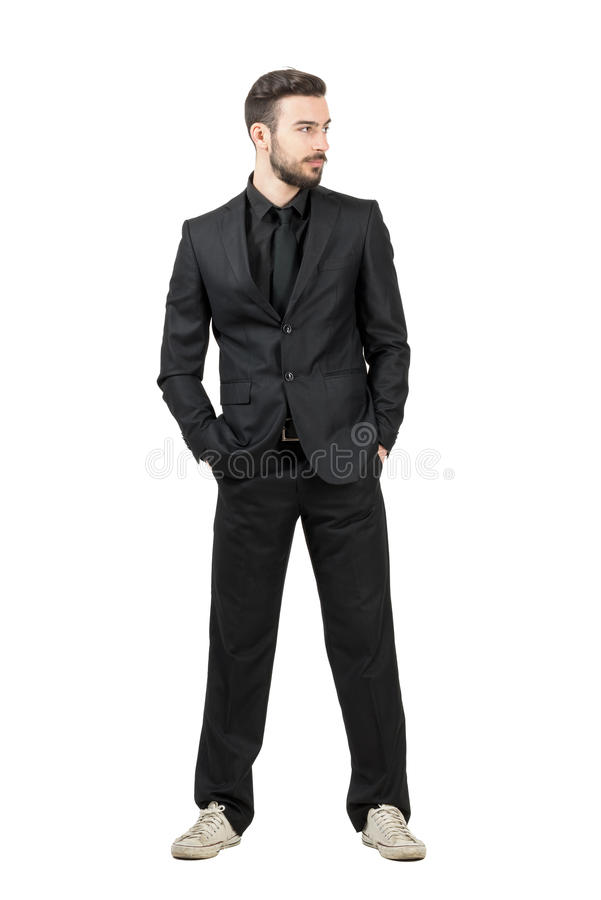 Young bearded businessman in white sneakers looking away stock photo