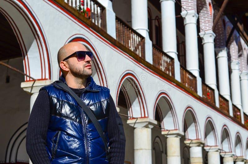 Young bearded handsome man. Young bearded beautiful smiling fashion man in Rila Monastery,Bulgaria stock photo