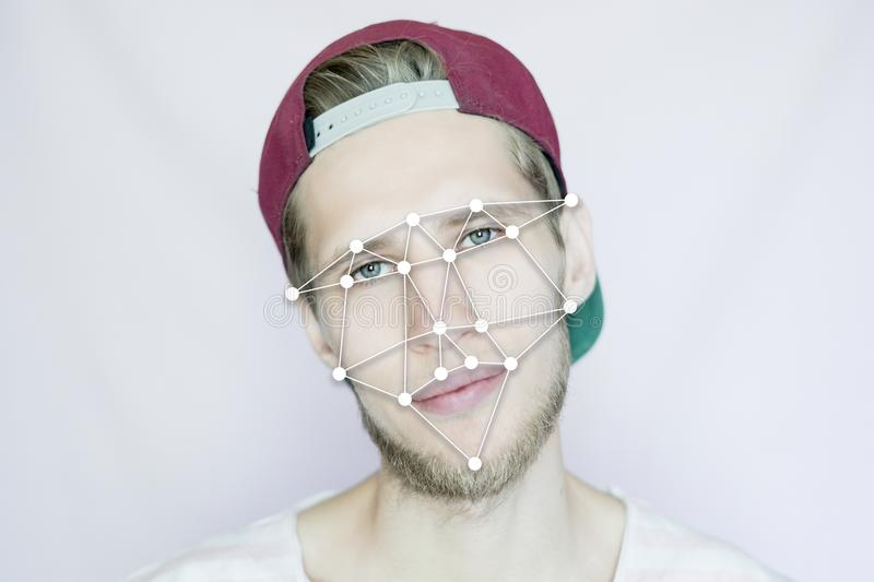 Young bearded hipster in a snapback cap biometric face scan isolated. Young bearded hipster in snapback cap biometric face scan isolated royalty free stock photo