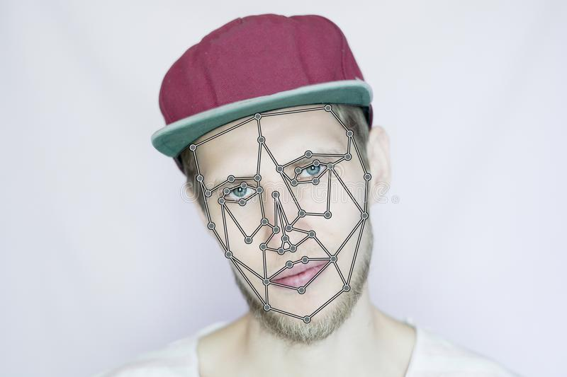 Young bearded hipster in a snapback cap biometric face scan isolated. Young bearded hipster in snapback cap biometric face scan isolated stock photography