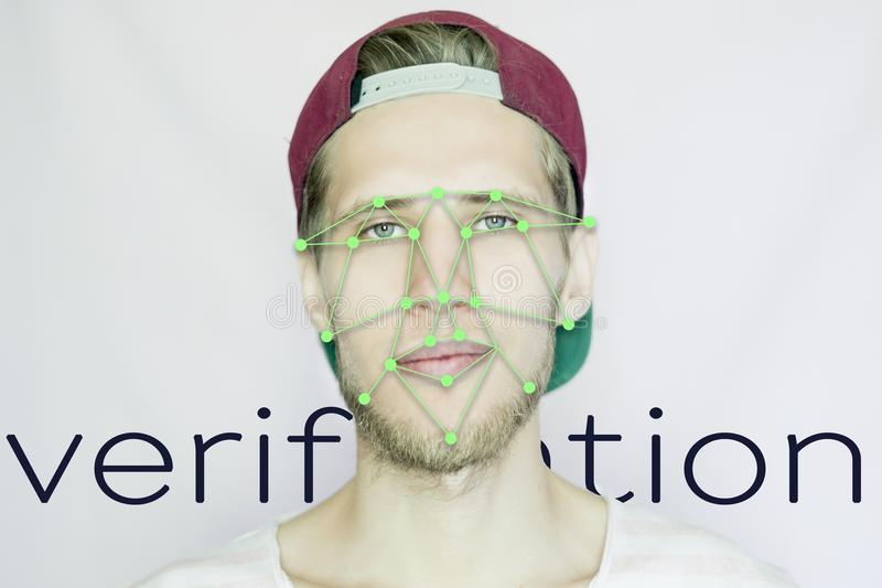 Young bearded hipster in a snapback cap biometric face scan isolated. Young bearded hipster in snapback cap biometric face scan isolated stock photo