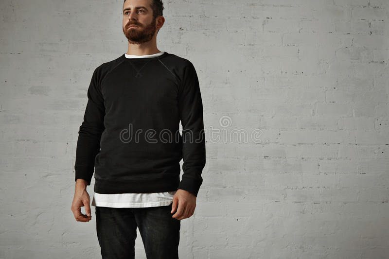 Young bearded man in blank black shirt royalty free stock photos