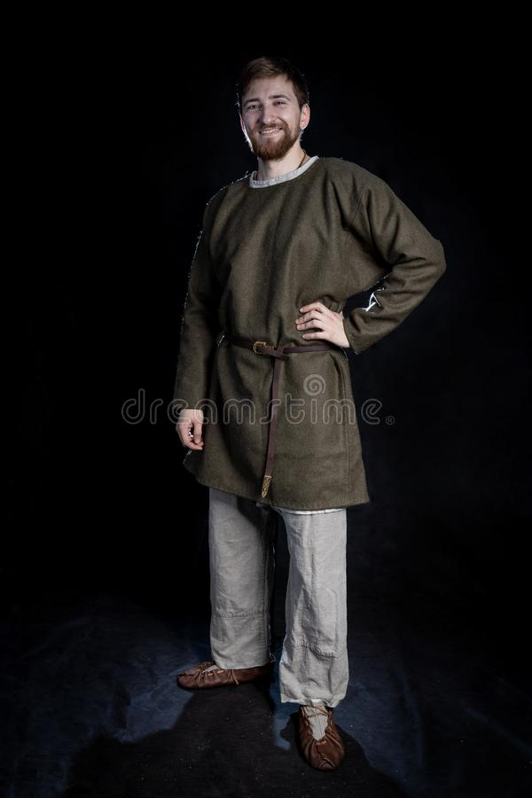 young bearded man in casual wear of a viking era smiling stock image
