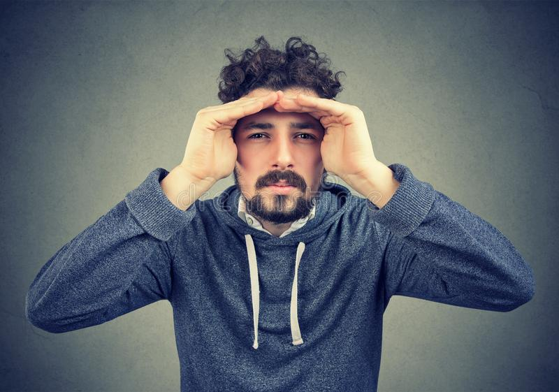 Hipster man looking faraway in search stock images