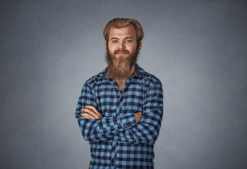 Young bearded man looking at you camera hands folded stock photos