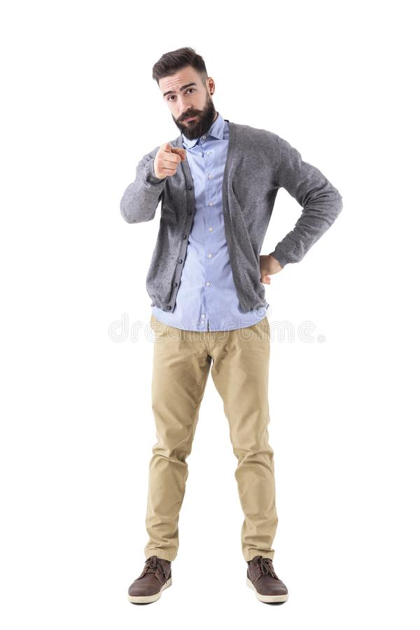 Young bearded stylish teacher or business man pointing finger at camera. Full body length portrait isolated on white studio background royalty free stock photos