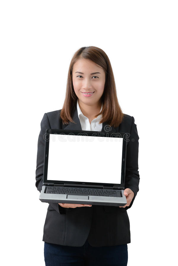 Young beautiful asian business woman holding laptop with blank s. Creen isolated on white background stock images