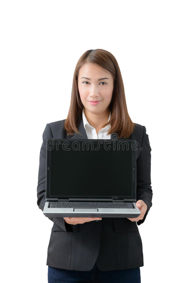 Young beautiful asian business woman holding laptop with blank s. Creen isolated on white background royalty free stock photo