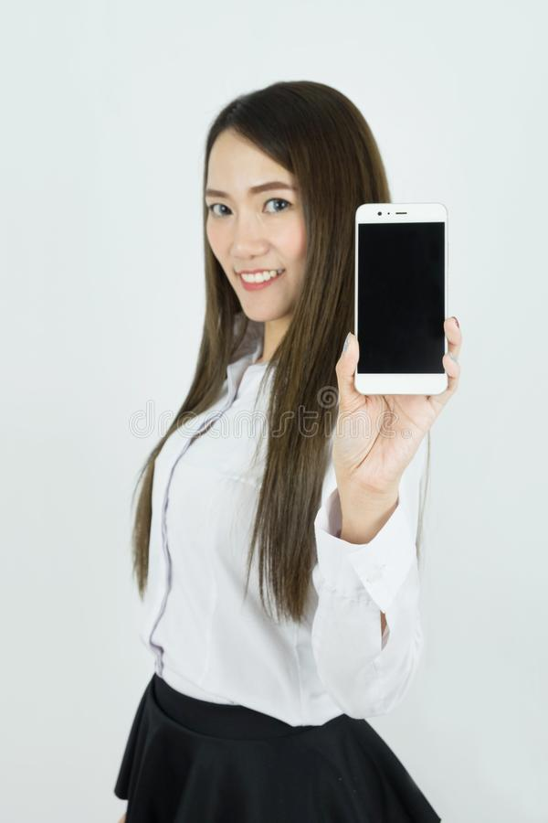 Young beautiful asian business woman smiling, Holding blank screen smart phone on white background. stock images