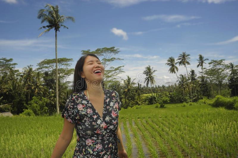 Young beautiful Asian Chinese tourist exploring jungle and rice field pad area in Bali Indonesia relaxed and happy enjoying holida royalty free stock image