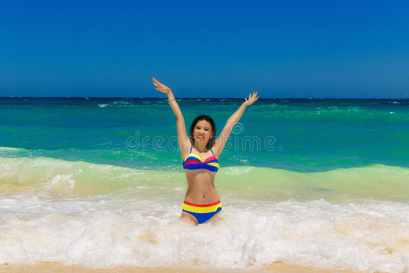 Young beautiful Asian girl with long black hair in bikini, on t royalty free stock images