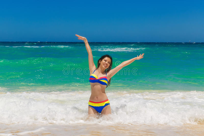 Young beautiful Asian girl with long black hair in bikini, on t royalty free stock photo