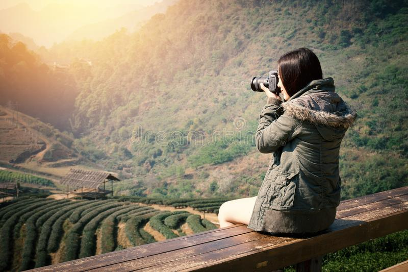 Young beautiful Asian tourist carry a digital camera royalty free stock photography