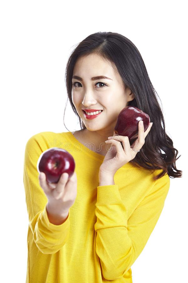 Young beautiful asian woman holding two apples royalty free stock photos