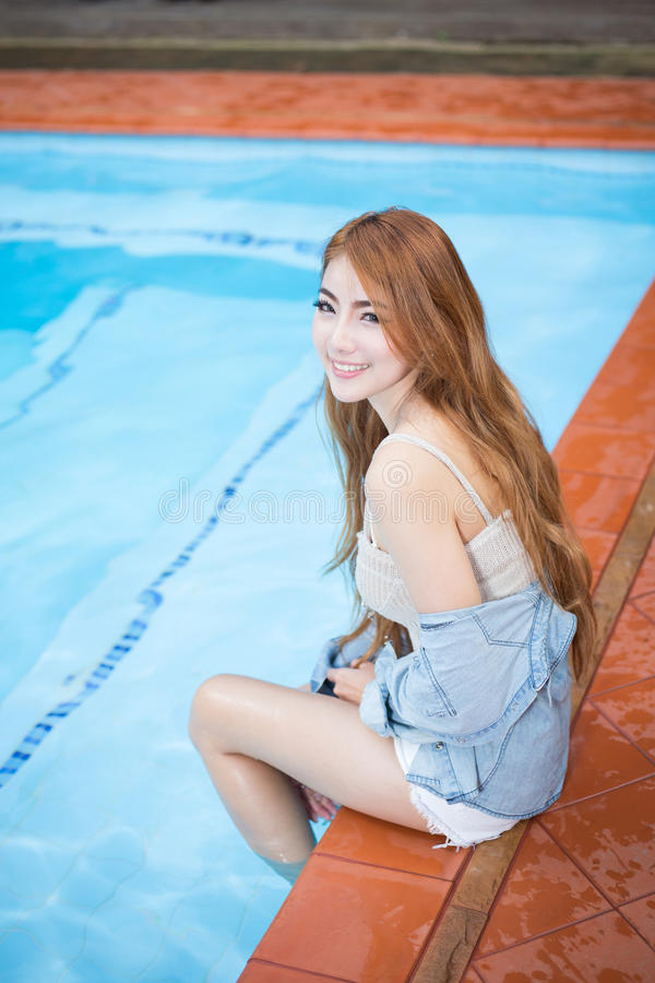 Young beautiful asian woman relaxing on Resort stock images