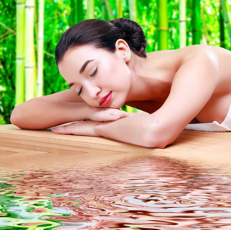 Young beautiful asian woman relaxing at spa salon stock photo