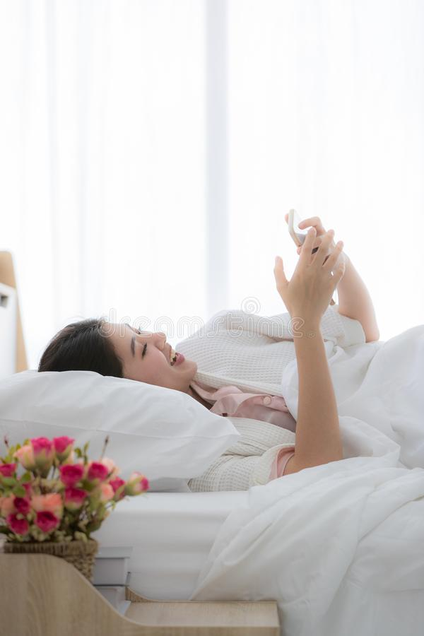Woman in bedroom royalty free stock photo