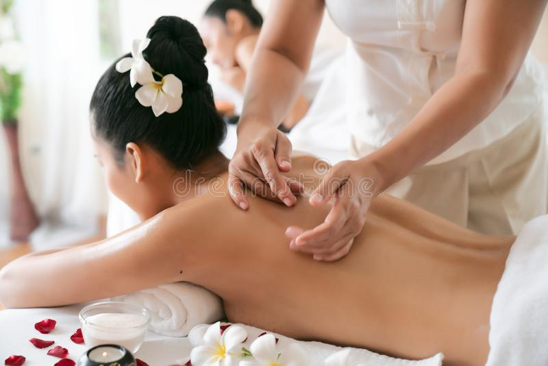 Young beautiful Asian woman sleep relaxing in the Oil spa massage in salon. Select focus hand of masseuse stock photos
