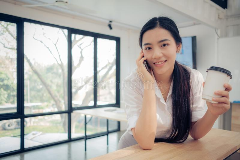 Young beautiful asian woman talking on her phone royalty free stock photos