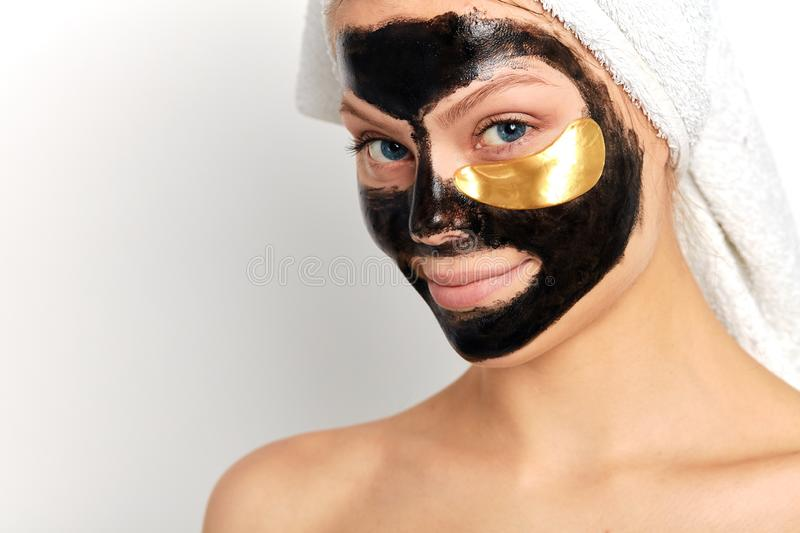 Young beautiful attarctive woman with a mask for the face stock photography