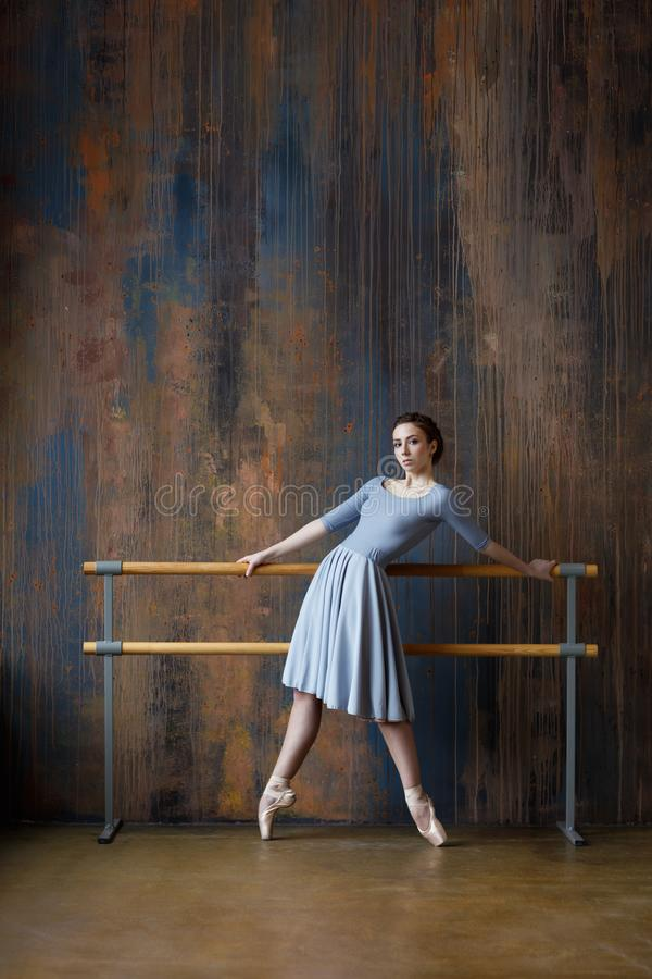 Young beautiful ballerina is posing in studio royalty free stock image