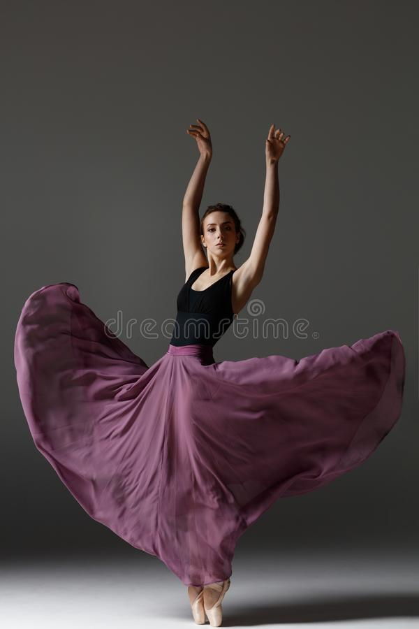 Young beautiful ballerina is posing in studio stock images