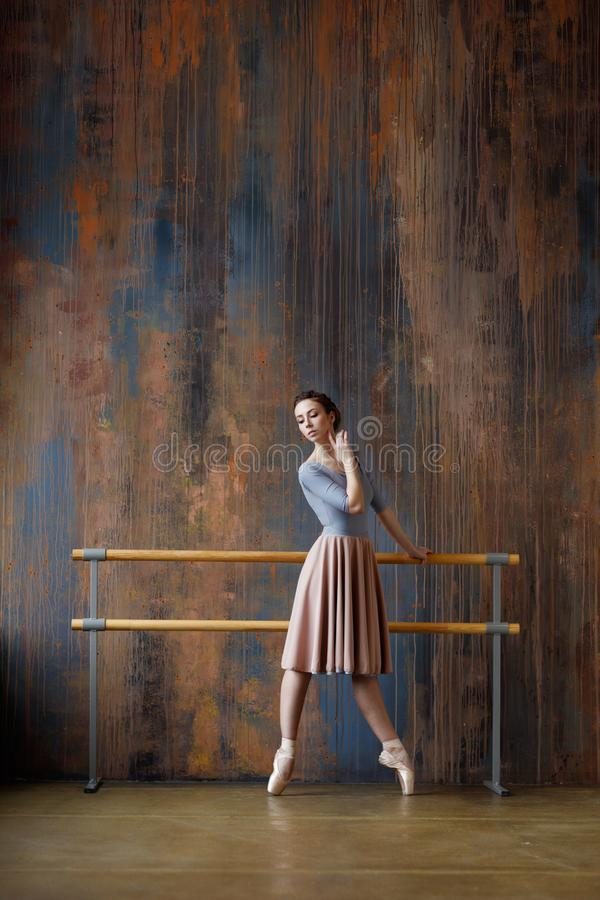 Young beautiful ballerina is posing in studio stock photos