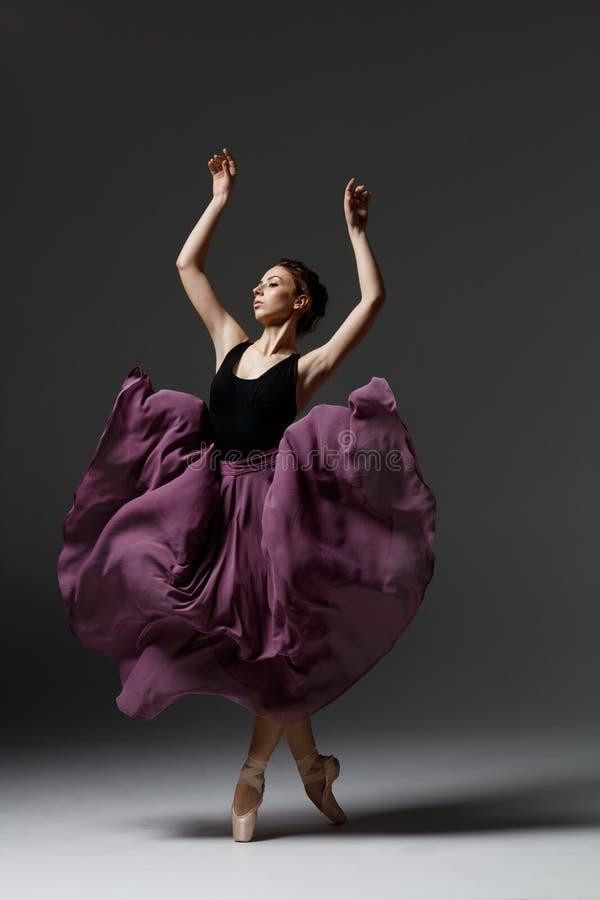 Young beautiful ballerina is posing in studio stock photography