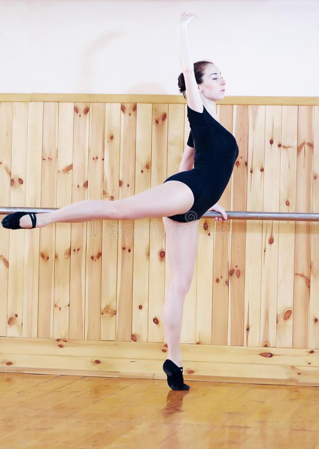 Young beautiful ballet dancer posing in fitness center stock photo
