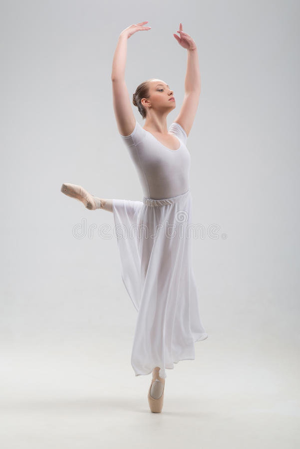 Young and beautiful ballet dancer posing isolated royalty free stock images