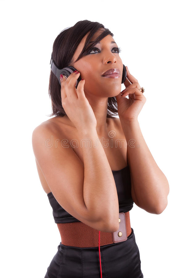 Download Young Beautiful Black Woman Listening To Music Stock Image - Image of attractive, look: 23614105