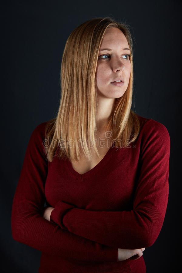 Young beautiful blond woman with crossed arms stock image