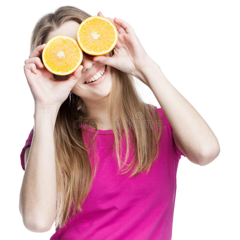 Young beautiful blond woman holding orange stock photo