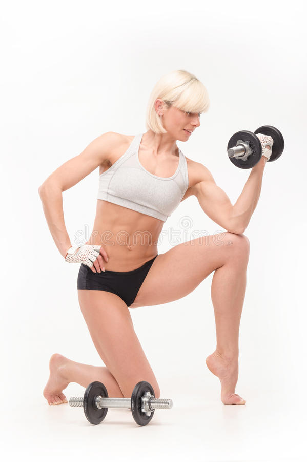 Young beautiful blonde with an athletic figure stock images